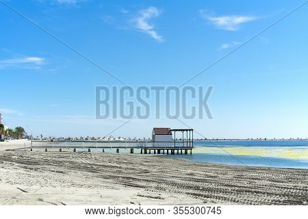 A View Of A Wooden Jetty, At The Coast At The Mar Menor, Spain.  The Sea Here Is Very Calm And The B