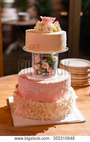 Multi-tiered Pink Wedding Cake With Fresh Flowers And Lace. Tradition.