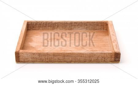Front view of small empty wooden tray isolated on white