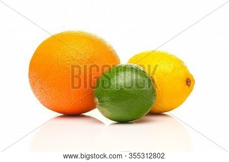 Fresh Citrus Fruits. Healthy Eating Concept. Orange, Lemon And Lime Isolated On A White Background.