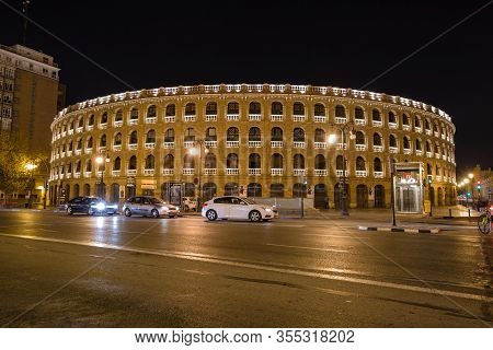 Valencia, Spain - October, 2019: Walking Night Streets Of Valencia Illuminated At Night. View Of Bul