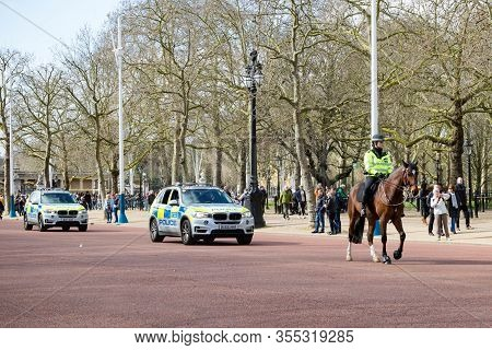 London, United Kingdom, March 8th 2020:- A Police Officer On Horseback And Police Vehicles Near Buck