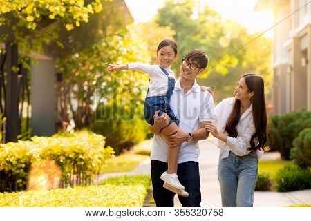 Asian Family Walking Together In The Village Gardent, This Image Can Use For Father, Mother , Daught