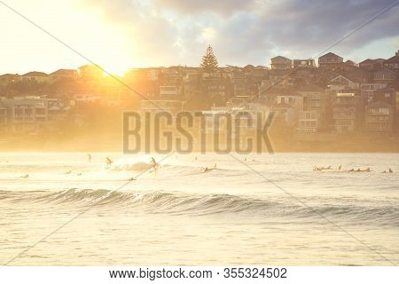 People Relaxing On The Bondi Beach In Sydney, Australia. Bondi Beach Is One Of The Most Famous Beach