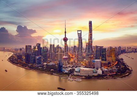 Sunset And  Cityscape Of Shanghai, China City Skyline On The Huangpu River.