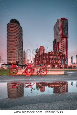 Rotterdam, The Netherlands 12 February 2019 - Hotel New York. Two Red Bicycles Parked In Front Of Th