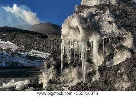 icicles and New South-east Summit Crater in Etna Park, Sicily
