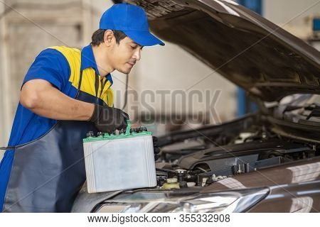 Action Of Man Hands Using Spanner Remove Car Battery Terminals To Change The New One, Car Fixing And