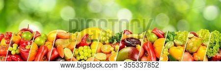 Large panoramic collection fruits, vegetables and berries separated by sloping lines on green blurred background.