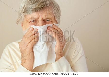 Running Nose. Older Woman Spending All Day Long While Having Running Nose. An Older Woman Has A Stuf