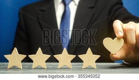 A Man Points To A Heart Instead Of A Fifth Star. Loyalty And Customer Choice. The Evaluation Of Visi