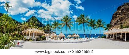 Sugar Beach Saint Lucia , A Public White Tropical Beach With Palm Trees And Luxury Beach Chairs On T