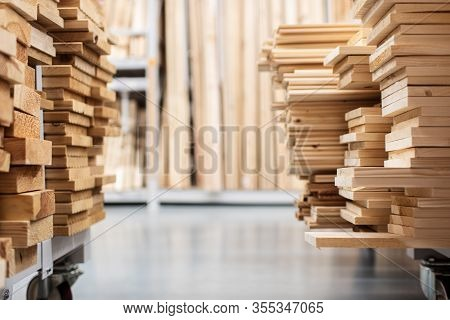 Stacked Wooden Boards In A Woodworking Industry. Stacks With Pine Lumber. Folded Edged Board. Wood H