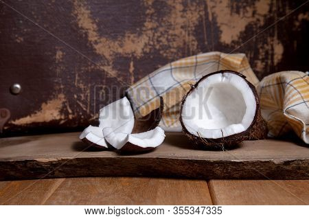 Coconut With White Pulp On Wooden Background..