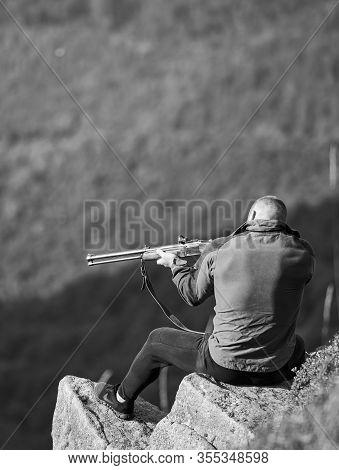 Hunter Spend Leisure Hunting. Man Brutal Gamekeeper Nature Landscape Background. Hunting In Mountain