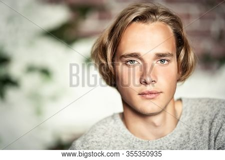 A portrait of a young goodlooking man. Casual men fashion.