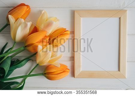 Poster Wooden Frame Mockup. Little Frame For Painting, Photo Or Poster. Bright Orange And Yellow Bou