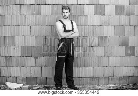 Ready To Work. Building Skills And Construction. Man Builder In Work Clothes. Man Build House. Skill