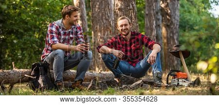 Two Men Relax In Forest. Hiking And Camping. Male Friendship. Man Best Friend Drink Beer. Ranger At