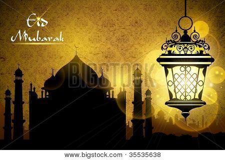 illustration of Eid Mubarak greeting with illuminated lamp