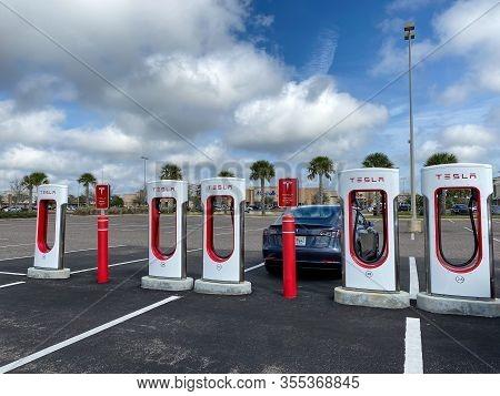 Melbourne, Fl/usa-3/4/20:  Cars Charging At A  Tesla Supercharger Station In Florida.