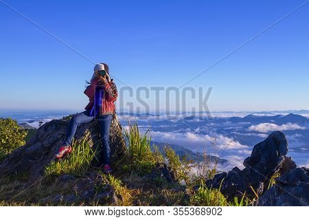 Traveler Is Making Picture And Fog Morning In Mountain On Viewpoint At Doi Pha Tang Chiang Rai Provi
