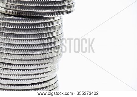 Stack Of Quarters, Isolated On White, Off Frame Stack Of Quarters.