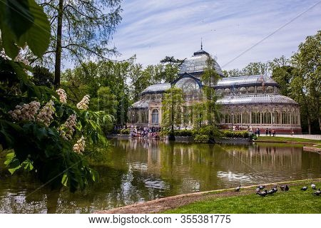 Madrid, Spain - May, 2018: View Of The Beautiful Palacio De Cristal A Conservatory Located In El Ret