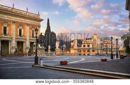 Rome Italy. Bronze statue of Roman Emperor Marcus Aurelius on steed at Capitol square among vintage buildings with ancient architecture. Evening sunset with clouds.