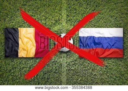 Canceled Soccer Game, Belgium Vs. Russia Flags On Soccer Field