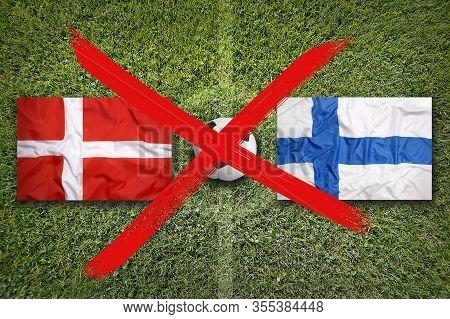 Canceled Soccer Game, Denmark Vs. Finland Flags On Green Soccer Field