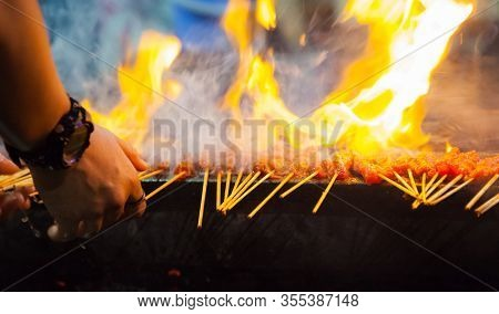 Grilled Pork Satay Is Marinated Pork Skewer Stick Barbecued On Charcoal Fire Grill. Asian Food Trave