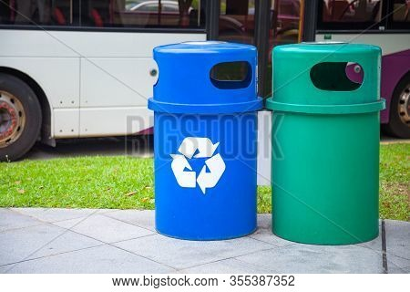 Blue Recycling Bin Collects Recyclables Or Recycled Material Like Glass Bottles, Jars, Cartons, Plas