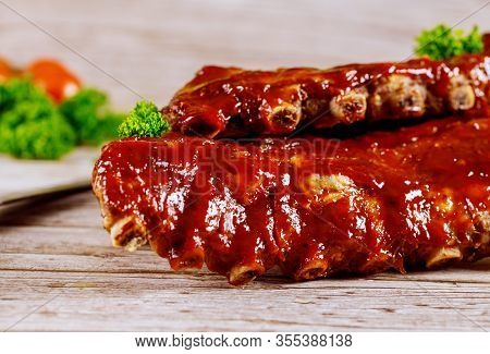 Delicious Bbq Pork Ribs With Parsley, Spinach And Tangy Bbq Sauce.
