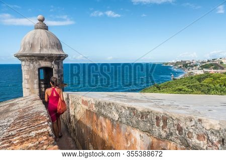 Puerto Rico travel cruise ship destination people walking at Castillo San Felipe del Morro in Old San Juan city summer vacation.