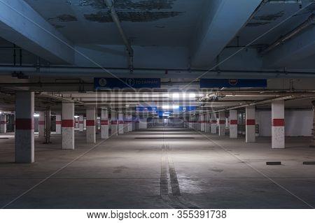 Empty Parking Garage In Dark. Architecture And Transportation Background