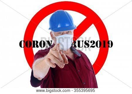 2019 Novel Coronavirus. 2019-nCoV. Wuhan, China 2019 Novel Coronavirus. Contractor with Paper Face Mask to avoid Coronavirus2019 and International NO Symbol Isolated in back.   Warning Sign. COVID19