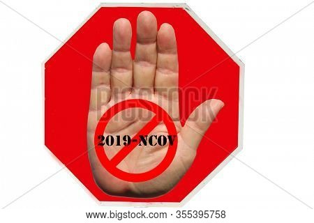 Coronavirus19. Coronavirus Stop Sign. Red USA Stop Sign with STOP CORONAVIRUS19 information. Isolated on white. Human Hand on a Red Stop Sign with the International NO symbol and 2019-NCOV text.
