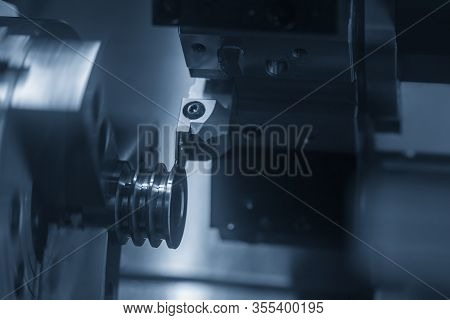 The Cnc Lathe Machine  Groove Cutting The Pulley Parts By Cutting Tool  . The Hi-technology Automoti