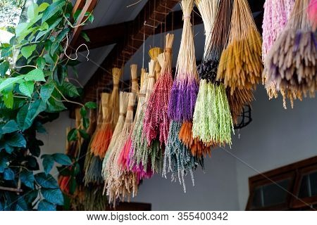 Hanging Colorful Bouquet Of Dry Flower And Grass Flower On Shoulder Pole, Decorative Design In Resta