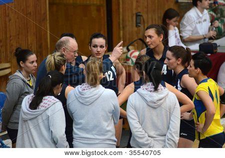 KAPOSVAR, HUNGARY - MARCH 16: Palota players listening to trainer at the Hungarian Championship volleyball game Kaposvar (blue) vs Palota (deep blue), March 16, 2012 in Kaposvar, Hungary