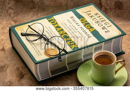 Fort Collins, CO, USA - March 8, 2020: The Books of Jacob (Polish edition), historical novel by Olga Tokarczuk with coffee and reading glasses - 2018 Nobel Prize in literature.