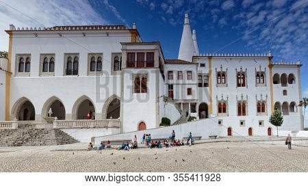 Sintra, Portugal - May 10, 2017: People in front of the National Palace of Sintra, the best-preserved medieval royal residence in Portugal. Since 1995, Sintra is listed as UNESCO World Heritage