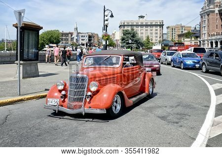 Victoria, British Columbia, Canada - June 17, 2018. Collectible Old Red Car Takes Part In A Car Para