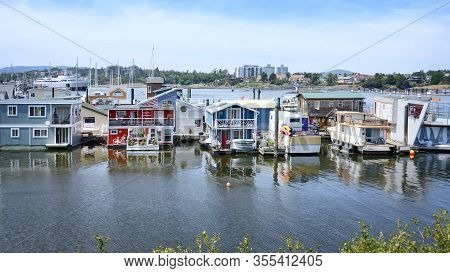 Victoria  City Inner Harbor Landscape. Village Of Colorful Floating Houses. Fisherman Wharf In Victo