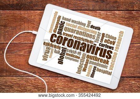coronavirus, covid-19 virus outbreak word cloud on a digital tablet, health, medical and social concept