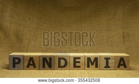 Wooden Cubes With Black Word Pandemia On Sackloth Background. Pandemia And Covid-19 Concept.