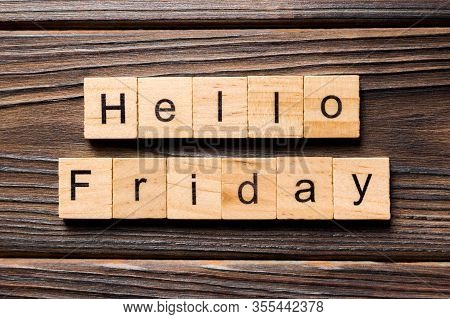 Hello Friday Word Written On Wood Block. Hello Friday Text On Wooden Table For Your Desing, Concept