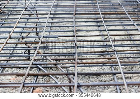 Background Of Reinforcing Steel Bars For Building Armature. Steel Reinforcement In The Construction