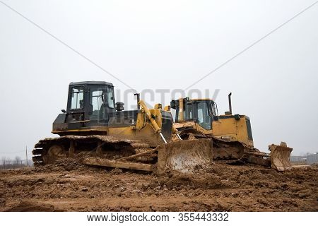 Dozer With Buckets At Construction Site. Bulldozer During Land Clearing, Grading, Pool Excavation, U